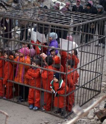 ISIS burn people in cage in Iraq