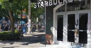 seattle mob burns Starbucks with residents living above it